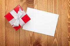 Red gift box over wooden background Royalty Free Stock Photography