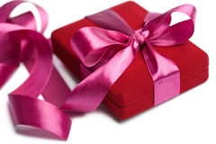 Red gift box with pink ribbon isolated Royalty Free Stock Photos