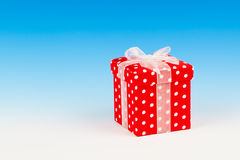 Red gift box, polka dots with bow Royalty Free Stock Photos