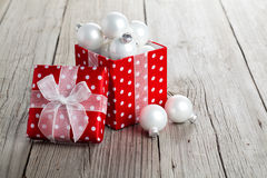 Red gift box, polka dots. With Christmas decoration, on wood background stock photography