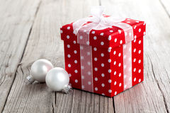 Red gift box, polka dots. On wood background stock images