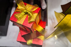 Red gift box present golden ribbon Stock Images