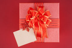 Red Gift box on red backgroud for Happy New Year Royalty Free Stock Images