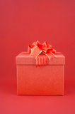 Red Gift box on red backgroud for Happy New Year Royalty Free Stock Photos