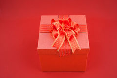 Red Gift box on red backgroud for Happy New Year Stock Images