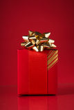Red gift box on red background. Stock Photo