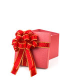 Red gift box with red and glod ribbon Royalty Free Stock Image