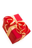 Red Gift Box with Red  and gold Satin Ribbon bow Royalty Free Stock Photography