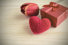Red gift box and red heart shape, Valentine's day Stock Photo