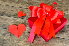 Red gift box and red heart shape Royalty Free Stock Photo