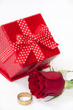 Red gift box with a red rose and golden ring Stock Photo