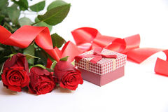 Red gift box and red roses royalty free stock photo