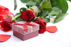 Red gift box and red roses Royalty Free Stock Image