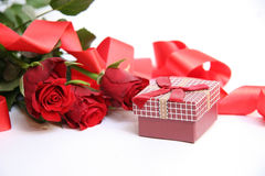 Red gift box and red roses Stock Photography