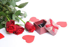 Red gift box and red roses Royalty Free Stock Photos