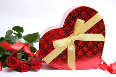 Red gift box and red roses Stock Images