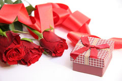 Red gift box and red roses IV Stock Photos