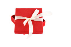 Red gift box with ribbon Royalty Free Stock Photos