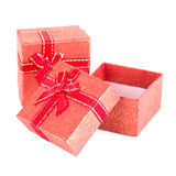 Red gift box with ribbon bow Stock Photos