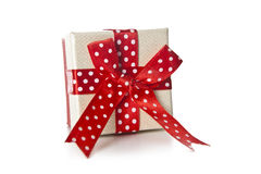 Red gift box with ribbon bow  on white background Stock Photo
