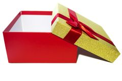 Red gift box with ribbon and gold cap isolated on white Stock Images