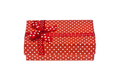 Red gift box with ribbon isolated on a white Royalty Free Stock Photography