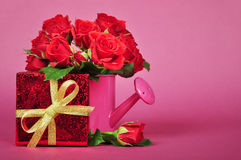 Red gift box with roses Stock Images