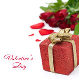 Red gift box and roses in the background, isolated. On white Stock Photos