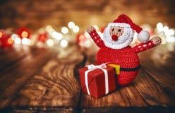 Red gift box, Santa Claus and Christmas garland Royalty Free Stock Images