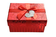 Red gift box with satin ribbon bow Stock Images