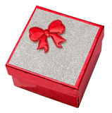 Red gift box with shinny silver cover and red bow, close up, isolated. Stock Images