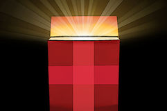 Red gift box with a shiny light inside Royalty Free Stock Image