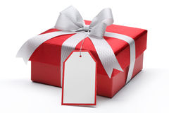 Red gift box. With silver bow and tag Stock Photo