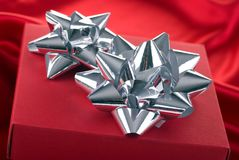 Red gift box with silver bows. Stock Photos
