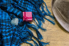 Red gift box, silver heart, Scarf and hat on wooden. valentine Stock Photography