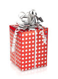 Red gift box with silver ribbon. Isolated on white background Royalty Free Stock Photography