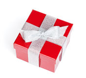 Red gift box with silver ribbon Royalty Free Stock Photos