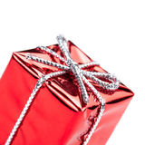 Red gift box with silver ribbon and bow isolated on white macro. Christmas, Valentine's, Birthday gift box Royalty Free Stock Images