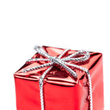 Red gift box with silver ribbon and bow isolated on white macro Royalty Free Stock Images