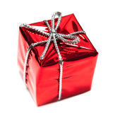 Red gift box with silver  ribbon isolated over white close up. Macro. Christmas red present Stock Photos