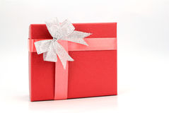 Red gift box with silver ribbon on white. Background Royalty Free Stock Image
