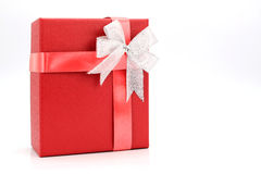 Red gift box with silver ribbon. On white background Stock Image