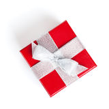 Red gift box with silver ribbon. On white background. View from above Stock Images