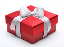 Red gift box with silver white ribbon bow Royalty Free Stock Photography