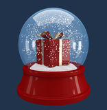Red gift box in a snow globe Stock Photos