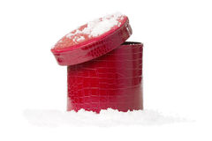 Red gift box on snow isolated  white background Royalty Free Stock Photos