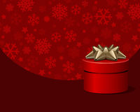 Red gift box and snowflakes Royalty Free Stock Photo