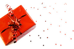 Red gift-box with stars isolated. Photo of a red gift-box decorated with red ribbon and little red stars, isolated on white background Stock Photos