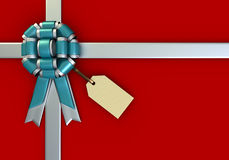 Red Gift Box and a Tag. On red background Stock Photos