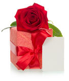 Red gift box with tag. Red gift box with bow, rose and tag Royalty Free Stock Images